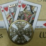 The bottom motif which combines the Celtic Symbol of Eternity with the King and Queen of Hearts where the card faces have caricatures of the bride and grooms faces.
