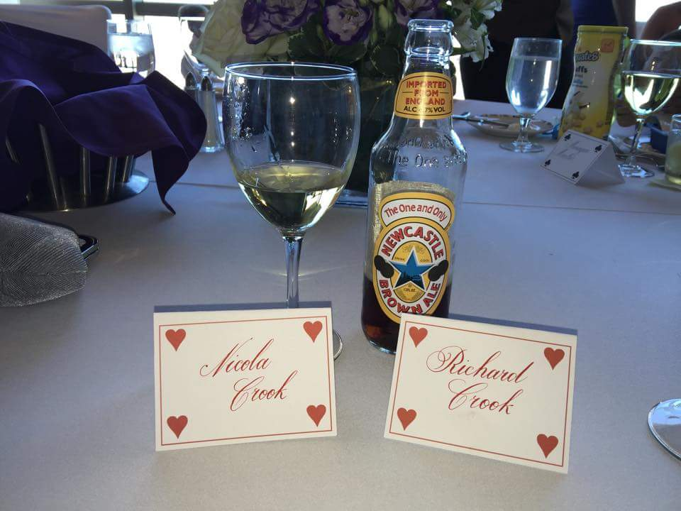 I printed suit of card themed place cards for each table which were completed in a copperplate script