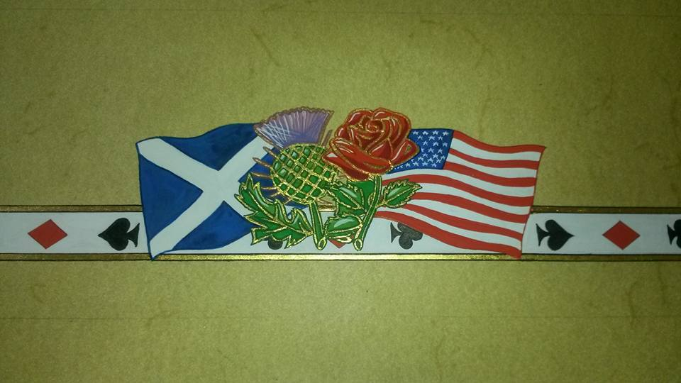 The top motif designed from the national flowers and flags of Scotland and the USA.  The Groom is Scottish and the Bride is American.